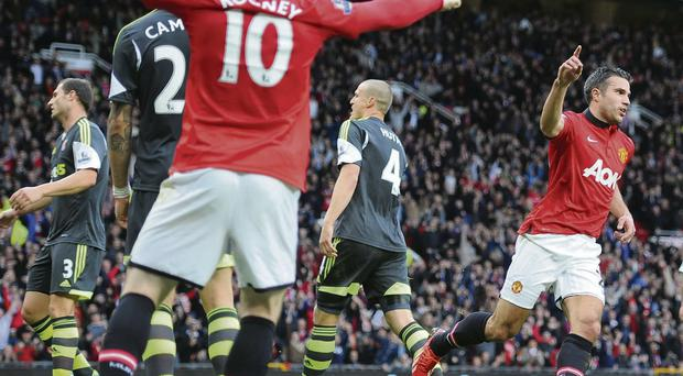 Manchester United's Robin Van Persie celebrates after scoring during the Barclays Premier League match at Old Trafford