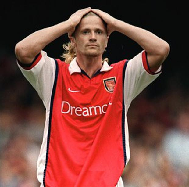 Emmanuel Petit, pictured, has warned Arsene Wenger not to pay any attention to Jose Mourinho's games