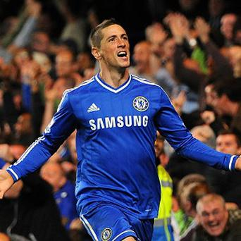 Fernando Torres scored the winner in a 2-1 victory over Manchester City