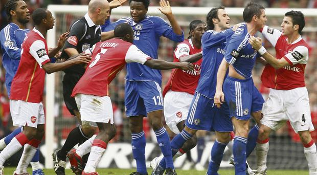 Frank Lampard and Cesc Fabregas clash during a row between Chelsea and Arsenal players in the 2007 Carling Cup final