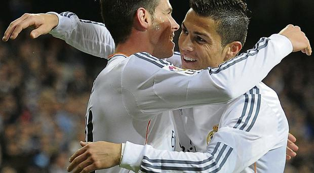 Cristiano Ronaldo congratulates Gareth Bale after the Welshman scored his first goal for Real Madrid on Wednesday