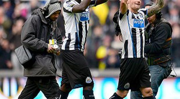 Moussa Sissoko, left, and Mathieu Debuchy celebrate Newcastle's win over Chelsea