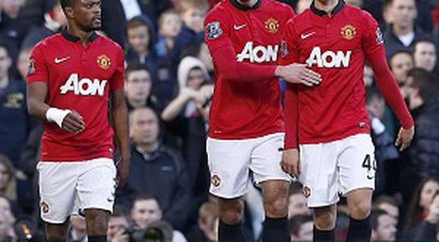 Antonio Valencia, Robin van Persie, centre, and Wayne Rooney were on target at Fulham