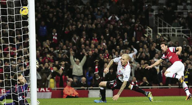 Santi Cazorla fires home Arsenal's opening goal against Liverpool