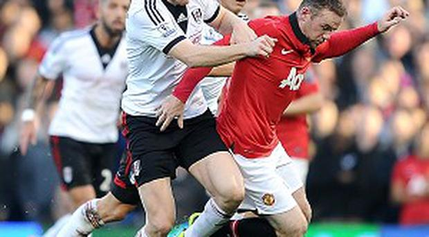 Wayne Rooney, right, scored one goal and set up another against Fulham