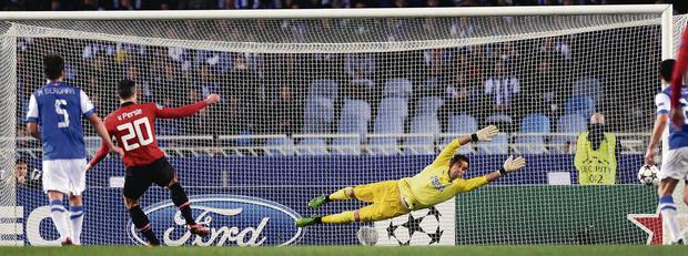 Robin van Persie fails to score from the penalty spot during the UEFA Champions League Group A match against Real Sociedad