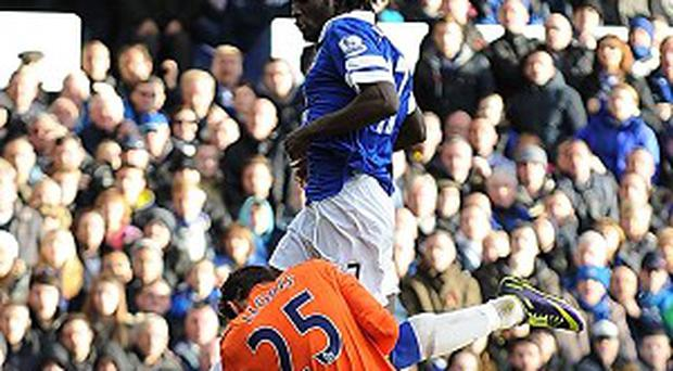 Romelu Lukaku, above, collided with Hugo Lloris, below, at Goodison Park on Sunday