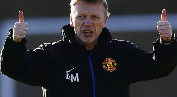 Manchester United's manager David Moyes gestures during a training session