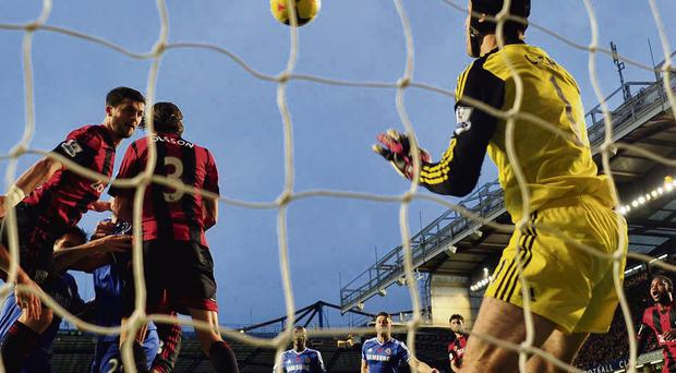 West Brom's Shane Long scores against Chelsea during their Premier League encounter at Stamford Bridge yesterday