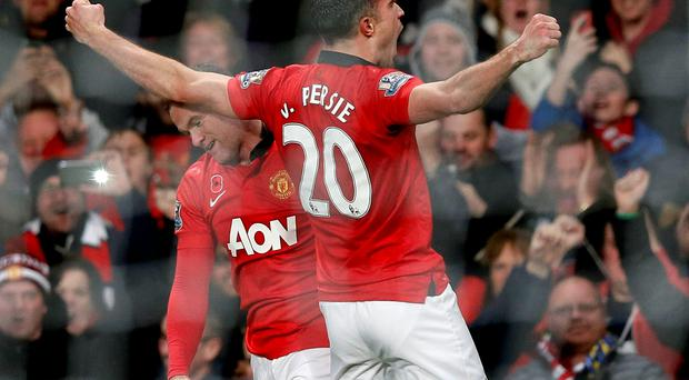 Robin Van Persie celebrates after scoring at Old Trafford - but he went off after 85 minutes