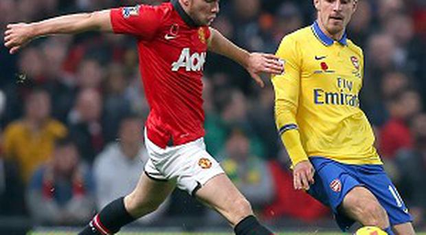 Tom Cleverley, left, says Manchester United 'are back in the mix' following their win over Arsenal