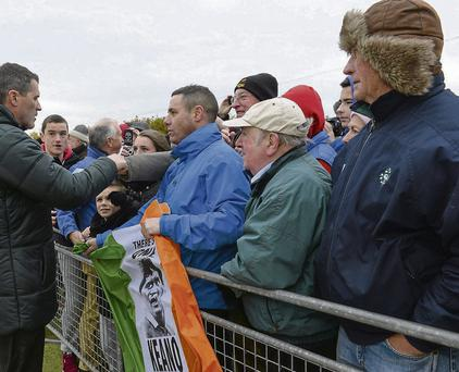 Roy Keane signs autographs for supporters at the end of the Irish squad training session at Gannon Park yesterday