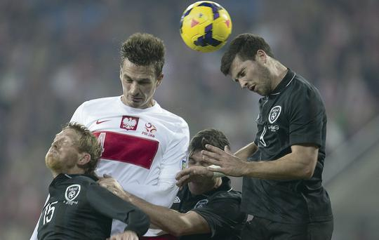 Lukasz Szukala of Poland fights for the ball with Irish trio (l-r) Paul Green, Stephen Ward and Shane Long.