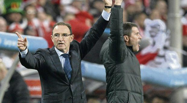 Martin O'Neill and Roy Keane gesture to officials during the friendly against Poland
