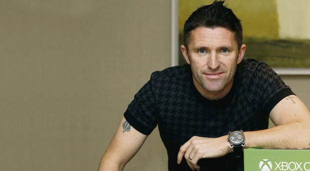 Irish captain Robbie Keane is pictured in Dublin ahead of the launch of Xbox One, which goes on sale today