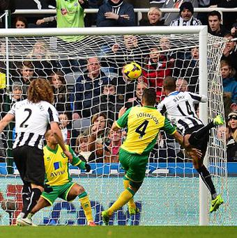 Loic Remy, right, scores the first goal