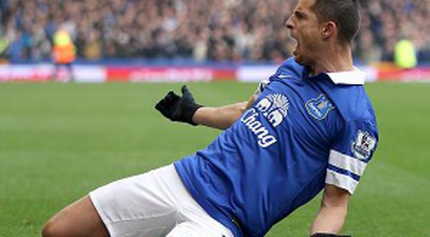 Brendan Rodgers felt Kevin Mirallas, pictured celebrating Everton's first goal, should have been sent off