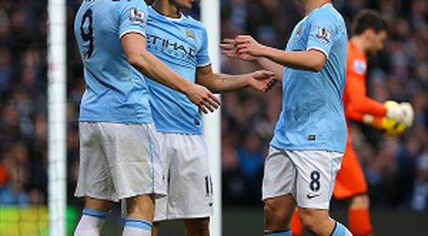 Alvaro Negredo, left, celebrates scoring Manchester City's fifth goal with Sergio Aguero, centre and Samir Nasri