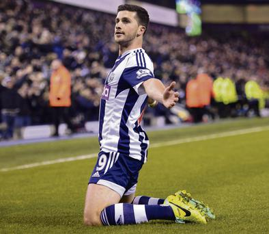 West Brom's Shane Long celebrates the second of his two goals in the Premier League clash with Aston Villa at The Hawthorns last night