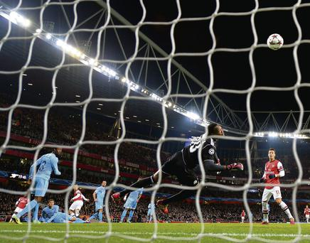 Steve Mandanda of Marseille fails to stop Jack Wilshere opening the scoring for Arsenal
