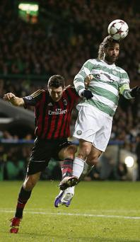 AC Milan's Daniele Bonera challenges Celtic's Georgios Samaras (R) during their Champions League clash at Parkhead