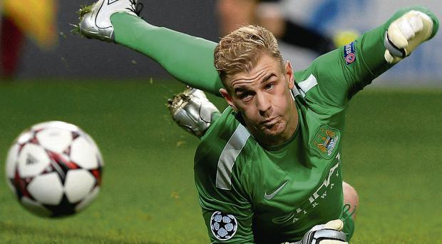 Manchester City's Joe Hart dives for the ball during their Champions League match against Viktoria Plzen