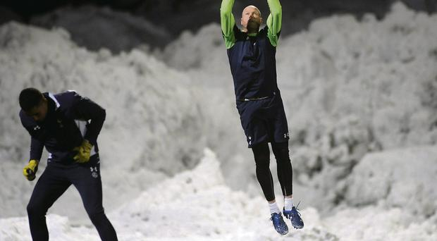 Brad Friedel warms up before Tottenham's game against Tromso