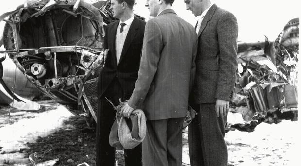 Devastation: Harry Gregg (left) and Bill Foulkes (right) survey the wreckage of the Munich air disaster in 1958