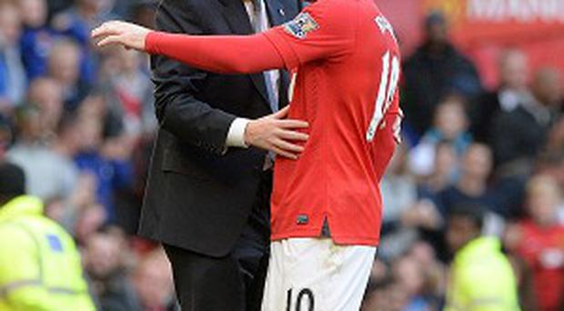 David Moyes, left, plans to keep playing Wayne Rooney, right, for the foreseeable future