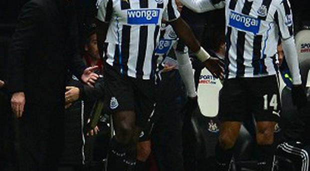 Moussa Sissoko, second from left, celebrates scoring the second goal