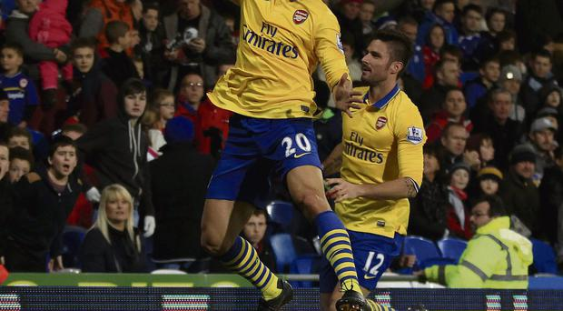 Arsenal's Mathieu Flamini celebrates scoring 2nd goal with Olivier Giroud (right) during the Barclays Premier League match at Cardiff City Stadium, Cardiff