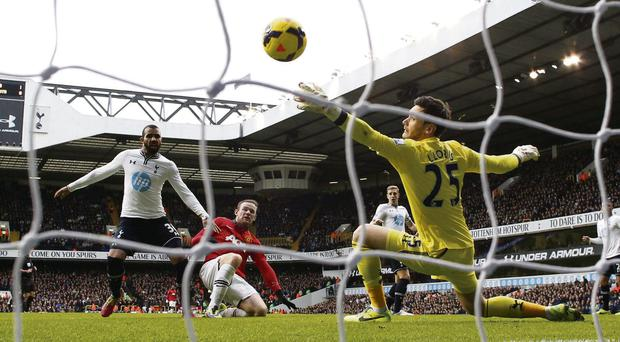 Sandro can only look on as Wayne Rooney stabs the ball past Hugo Lloris to score for Manchester United