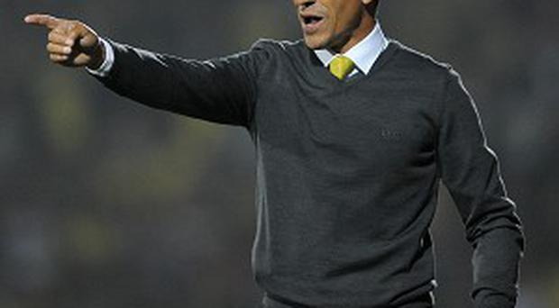 Chris Hughton is expecting a tough task at Anfield