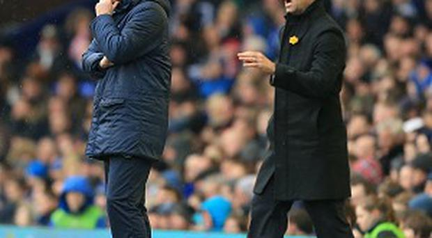 David Moyes, left, goes head-to-head with his Everton successor Roberto Martinez, right, on Wednesday