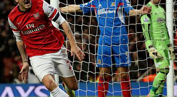 Nicklas Bendtner wheels away in celebration after putting Arsenal in front