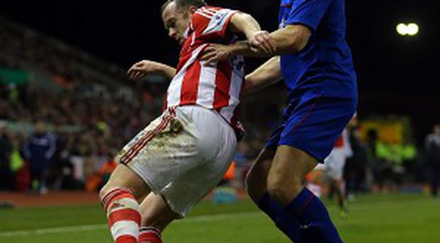Charlie Adam, left, was already on a booking when he pushed Frazier Campbell