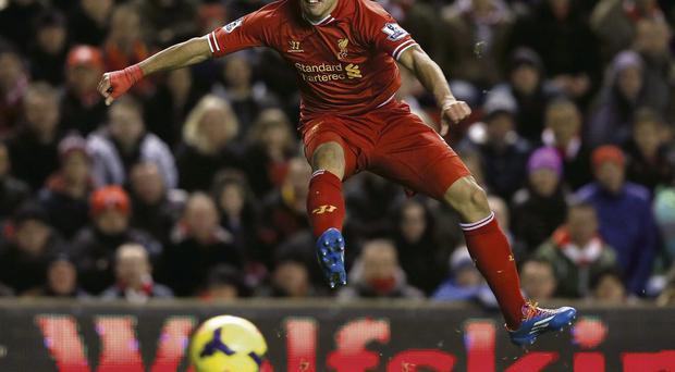 Luis Suarez lets fly during his four-goal performance for Liverpool against Norwich at Anfield