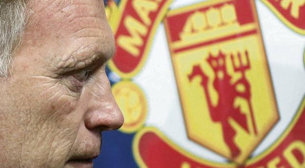 With Manchester United 12 points behind Arsenal, David Moyes finds himself between a rock and hard place
