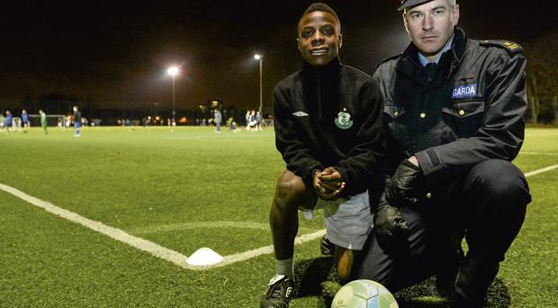 Tallaght footballer Fuad Sule and Garda Pat Courtney who were both in attendance at the finals of the Late Night Leagues in Irishtown