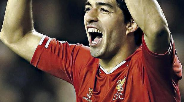 Liverpool's Luis Suarez celebrates after scoring against West Ham United
