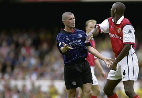 Keane clashes with Vieira at Highbury during their nine-year rivalry