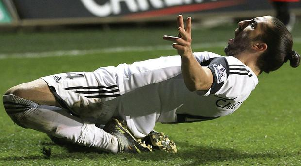 Swansea City's Chico celebrates after scoring his team's opening goal during the Barclays Premier League