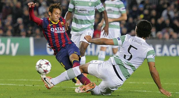 Neymar beats Virgil van Dijk to the ball to score Barcelona's fourth goal against Celtic at the Nou Camp last night