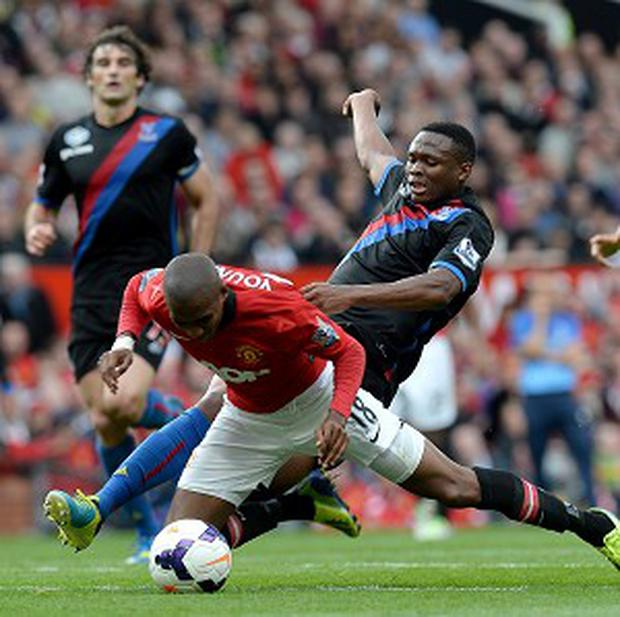 Ashley Young, front, has been booked for diving this term