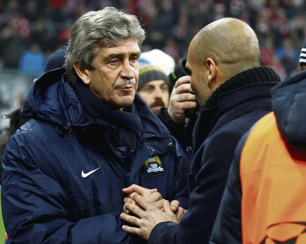 Manuel Pellegrini is congratulated by Bayern Munich manager Pep Guardiola after Manchester City's Champions League victory REUTERS