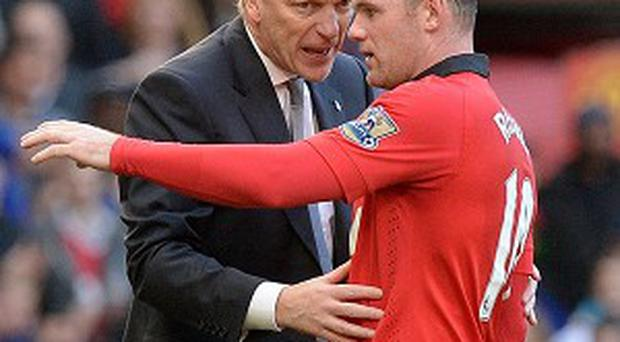 David Moyes, left, has backed Wayne Rooney, right, to break Man United's all-time goalscoring record