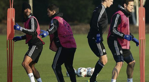 Chelsea defender Ashley Cole (left) in action during training RICHARD HEATHCOTE