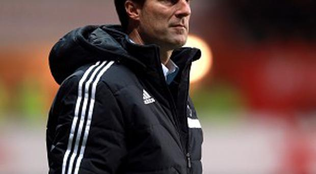 Michael Laudrup expects a tough test against Norwich