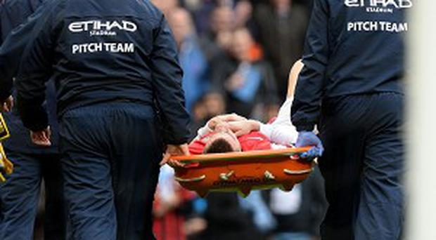 Laurent Koscielny was hurt trying to prevent Manchester City's second goal