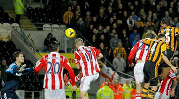 Curtis Davies, right, fails to beat Asmir Begovic, left, in the goalless draw at the KC Stadium